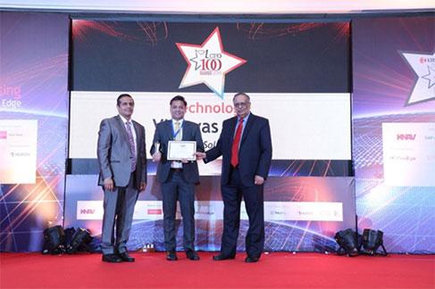 Vishwas More (Center) receives CFO100 Trophy & Certificate from Mr. Damodaran (Right) Ex-Chairman, SEBI